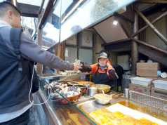 Mobile payment in Asia on the rise: Street food in Customer paying street food with his smartphone in Chengdu, China (Source: B.Zhou/Shutterstock.com